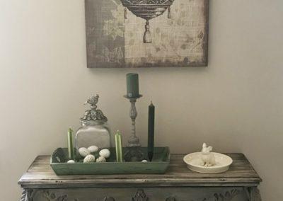 Wandboard und Bild mit Vögelchen und Käfig